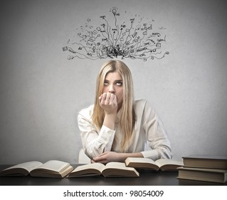 Young student with thoughtful expression sitting at a desk on some books with tangled lines and symbols coming out of her head