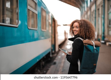 Young student at a train station.