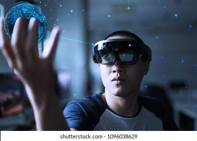 Young student try microsoft hololen to control virtual reality world in the hand | Future of world in hand