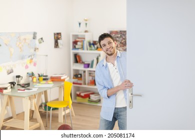 young student welcoming us into his apartment