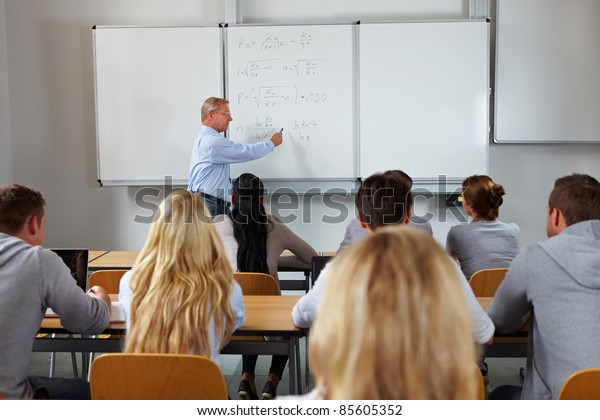 Young students in class at economic studies at university