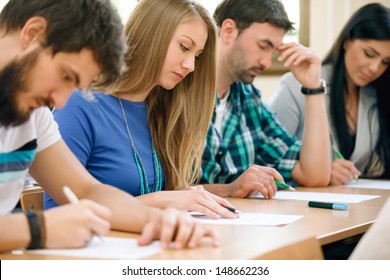 Young students having a test in a classroom