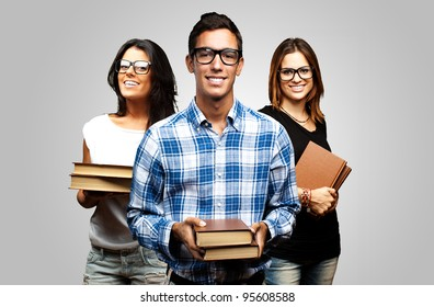 young students holding books over grey background