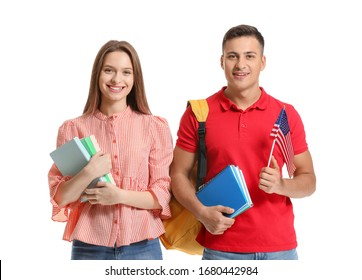 Young students of language school on white background