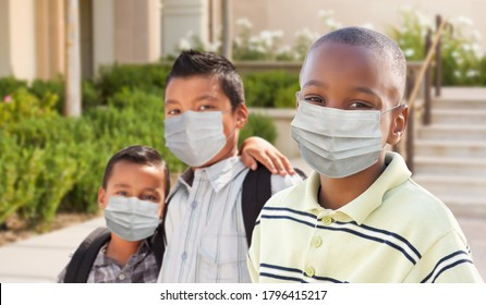 Young Students on School Campus Wearing Medical Face Mask During Coronavirus Pandemic.