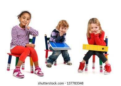 Young students seated in a chair isolated in white