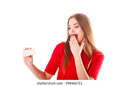 Young stylish and beautiful model girl with a smile different emotions, red lipstick in a red dress holds a sheet of white paper with free space for an inscription isolate on a white background