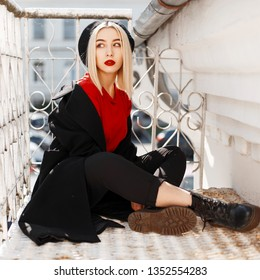 aa8604c2e5788f Young stylish blonde woman with red lips in a fashionable coat with a black  beret in