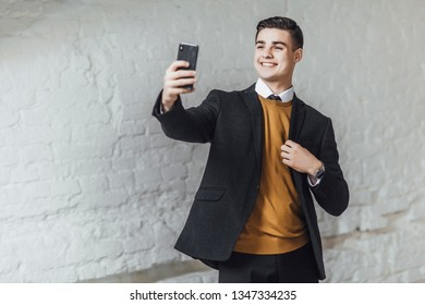 Young stylish businessman make a selpie at ofice and smiling. Lifestyle!