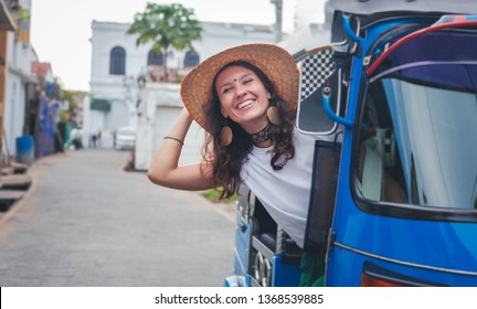 Young stylish european girl woman sitting in tuk-tuk traditional transport in Asia Galle, traditional transport in Sri Lanka, travel Ceylon Island