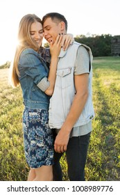 Young stylish fashion couple smiling in summer in field.