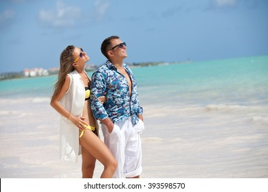 Young stylish fashion couple in summer luxury vacation. Vacations And Tourism Concept. Tropical Resort.