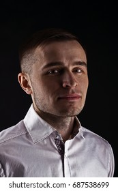 young stylish fashionable man with short hair posing in the camera, studio shot