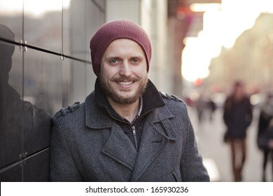 Young, stylish hipster with moustache and beard smiling