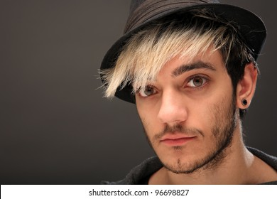 young stylish man with green eyes wearing a hat