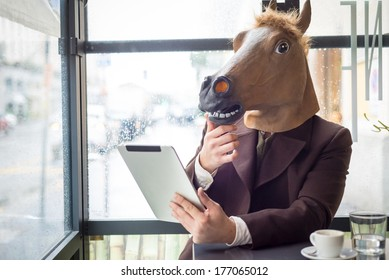 young stylish man lifestyle horse mask at the bar in the city