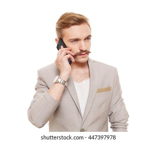 Young stylish man talking on mobile. Handsome businessman with mustache speak on cell phone isolated on white. Male portrait, communication and modern technology concept