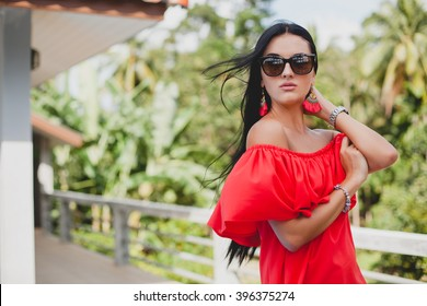 66c5a95d72 young stylish sexy woman in red summer dress standing on terrace in  tropical hotel