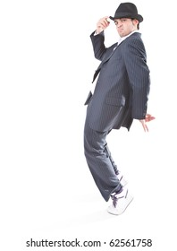 Young stylish teenager is showing dance moves like Michael Jackson. Isolated over white background.
