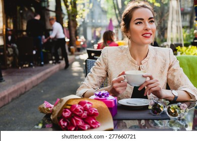 young stylish woman, fashion sunglasses, sitting in cafe, holding drinking cup cappuccino, tulips, happy birthday party, city street, boho outfit, europe vacation, romantic dinner, sunny, smiling