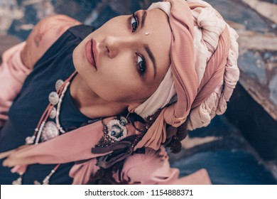 young stylish woman with fashionable boho accessories portrait