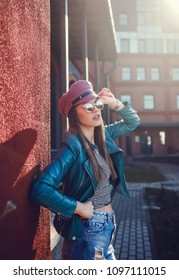 Young stylish woman in jacket and sunglasses