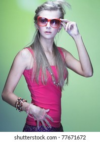 Young stylish woman with  sunglasses