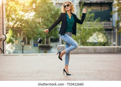 young stylish woman walking in city