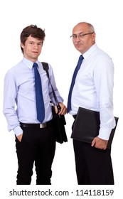 Young successful attractive smiling businessman and senior businessman in blue shirts, isolated on white background