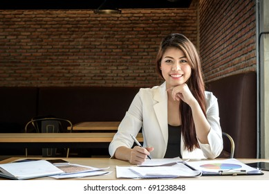 young successful beautiful professional business woman in office