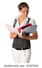 The young successful business woman with folders for documents in hands on a white background.