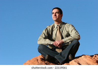 Young successful businessman posing outdoors