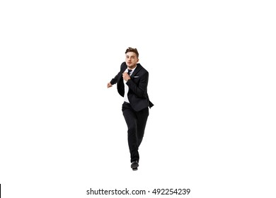 Young successful businessman in suit running over white background.