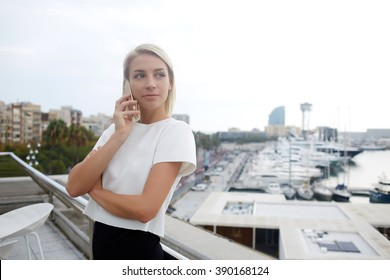 Young successful businesswoman is calling via smart phone,while she is waiting meeting with investors. Beautiful female is phoning via cell telephone during her leisure time in summer weekend overseas
