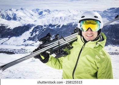 Young successful men ski mountain winter resort