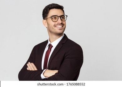 Young successful smiling business man with crossed arms looking away. CEO, cheif executive officer concept