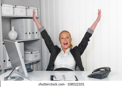 a young successful woman sitting at her desk in the office.