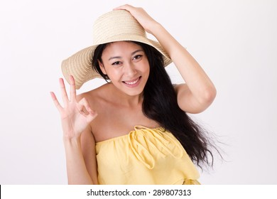 young summer woman giving ok hand sign