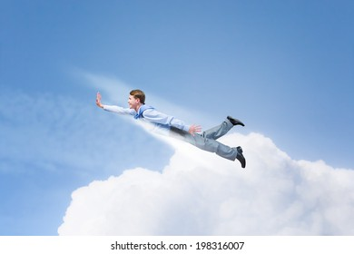 Young super businessman flying high in sky