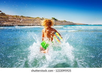 Young surfer preparing to ride the wave