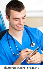 young surgeon writing on a clipboard wearing scrubs and a stethoscope