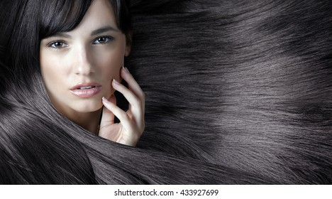 young sweet girl with beautiful hands and fresh skin, natural makeup and shining hair