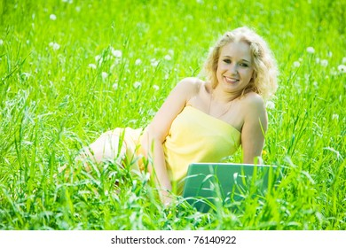 Young sweet girl relaxing with laptop outdoor