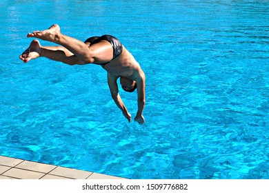 Young swimmer dives into the pool