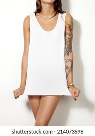 Young tattooed woman wearing blank sleeveless t-shirt