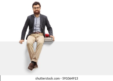 Young teacher sitting on a panel and looking at the camera isolated on white background