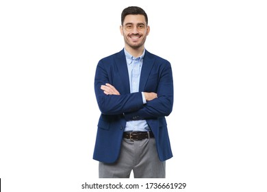 Young teacher wearing blue blazer, casual shirt and trousers, holding arms crossed, looking at camera with confident happy smile, isolated on white background