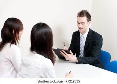young teacher writing in the meeting room