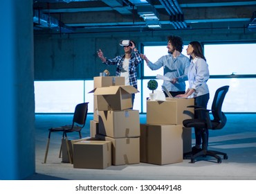young team of business people in group, architect and engineer on construction site checking documents and business workflow using the virtual reality headset and laptop computer in new startup office