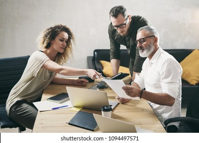 Young team of coworkers making great work discussion in modern office.Bearded man talking with marketing director and assistant manager.Business people meeting concept
